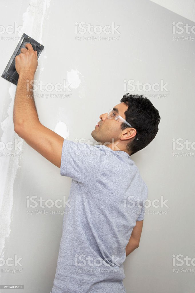 Man re-decorating home stock photo