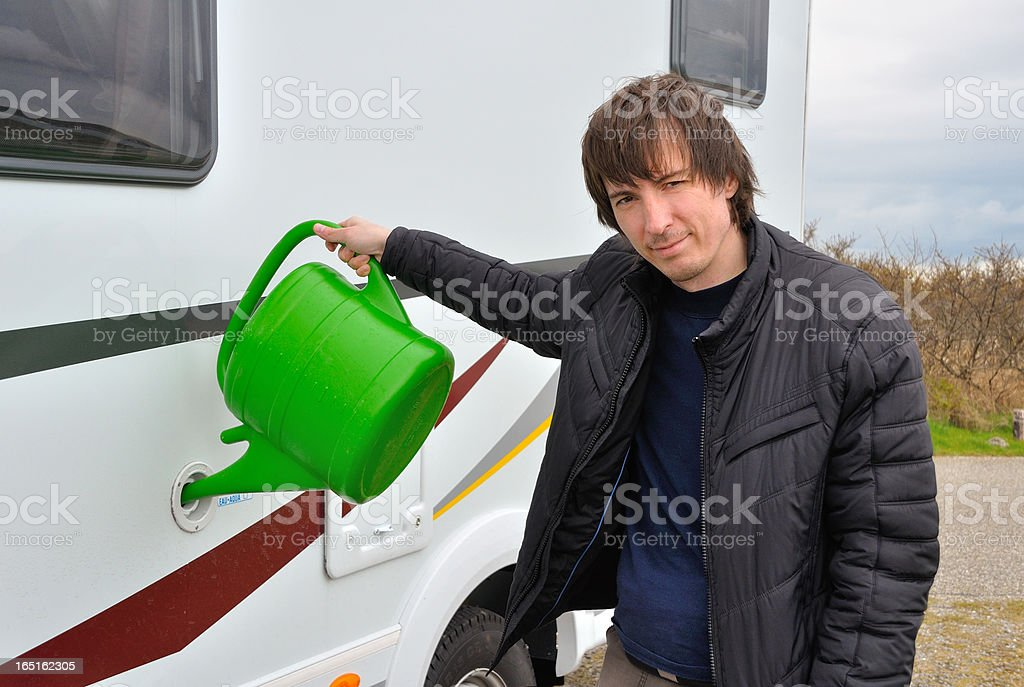 Man refilling camper (RV) water tank royalty-free stock photo