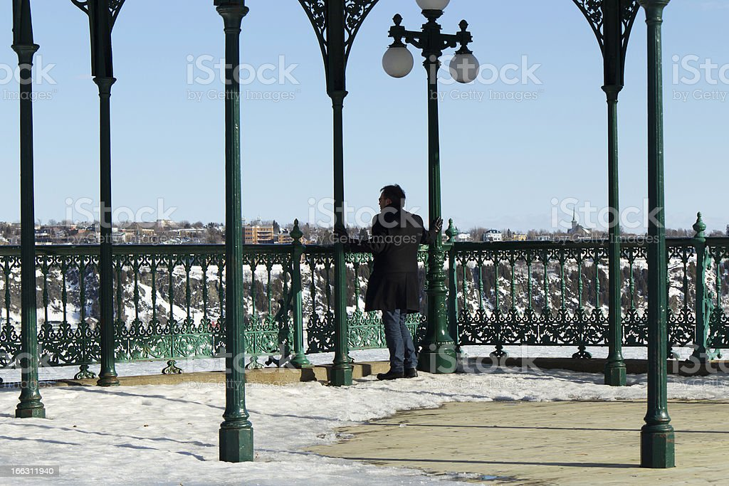Man reflecting at an overlook observation deck royalty-free stock photo