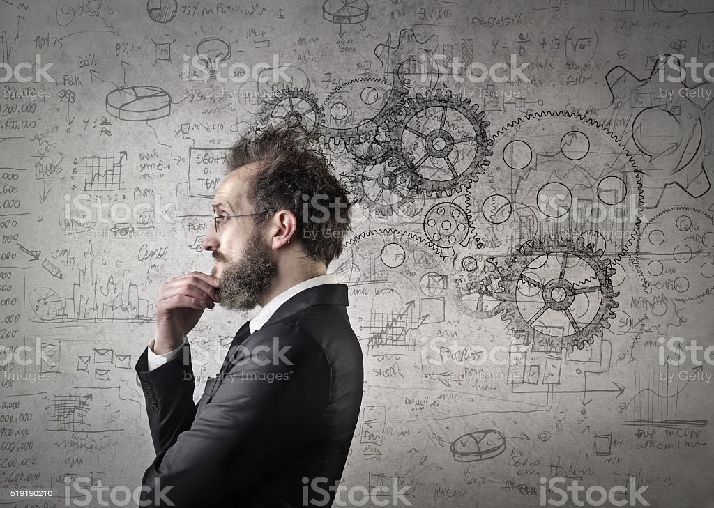 Man reflecting ideas stock photo