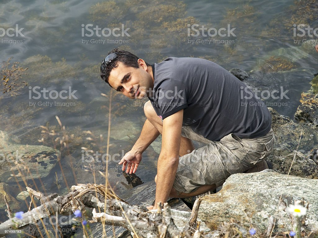 Man refreshing in the water stock photo