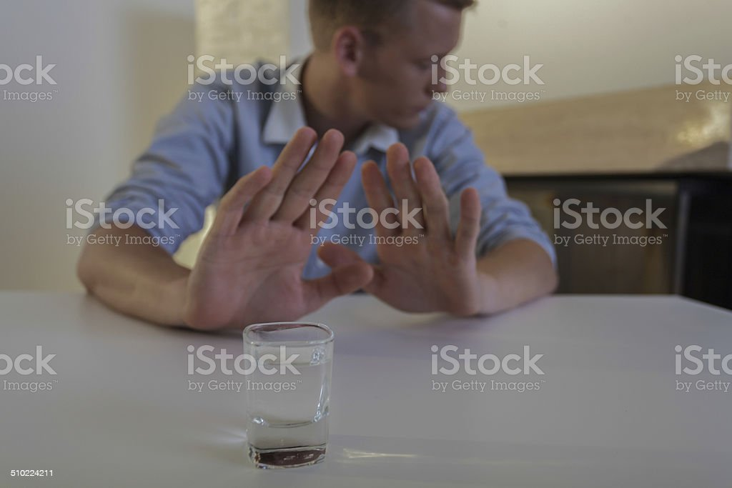 Man refuses drinking vodka stock photo
