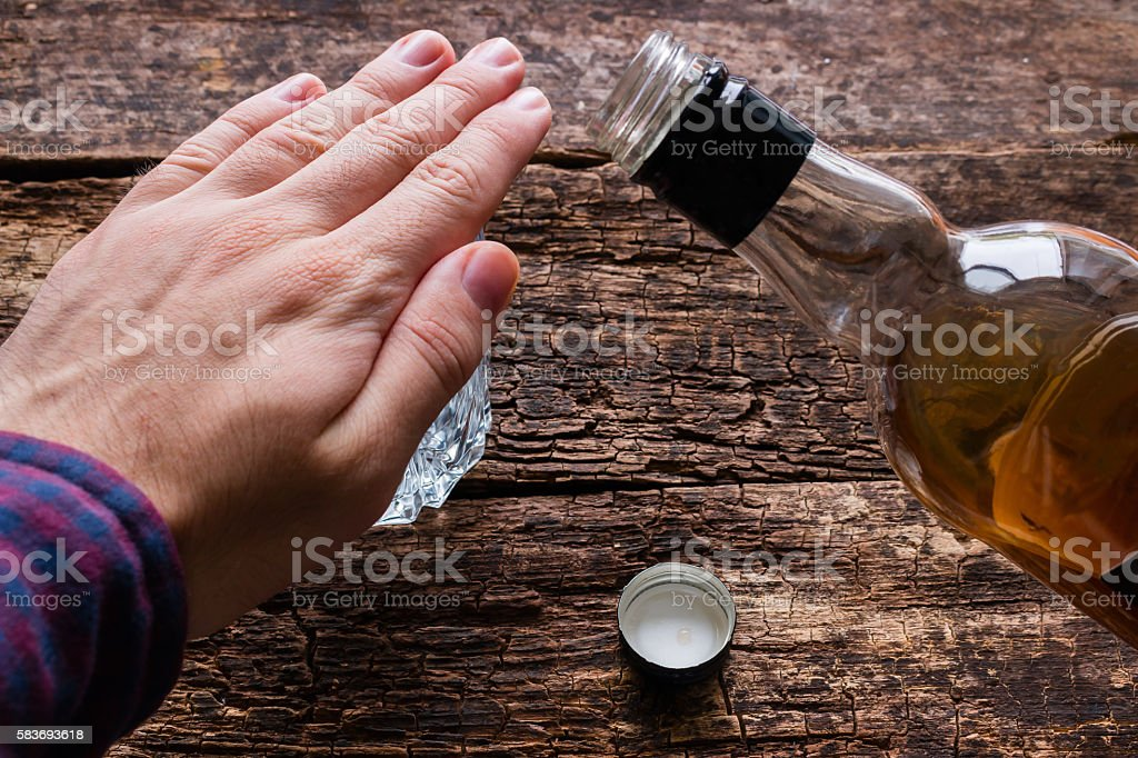 man refuses to drink alcohol stock photo