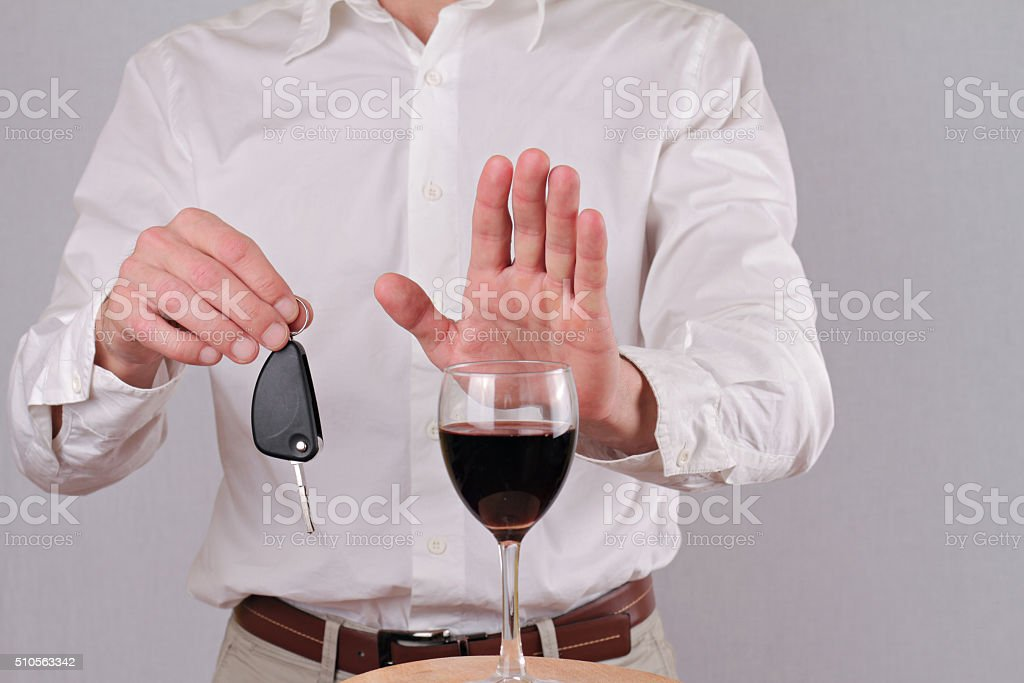 Man refuses to drink wine. Don't drink and drive concept stock photo