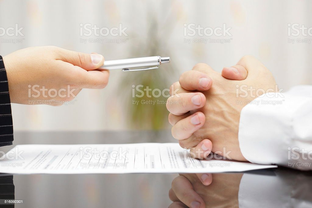 man refusing to sign a document stock photo