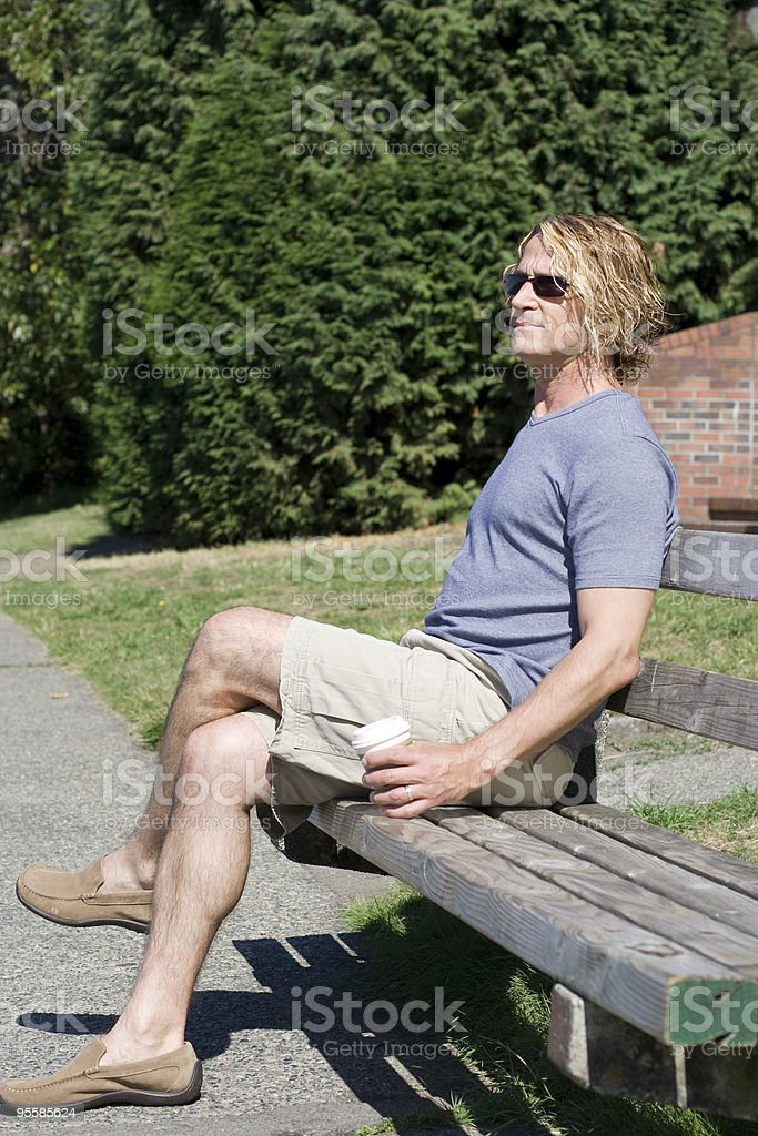 Man relaxes in park with coffee royalty-free stock photo