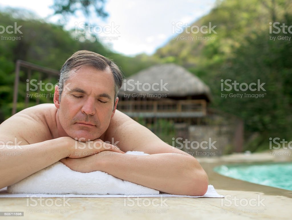 Man relaxing at the spa stock photo