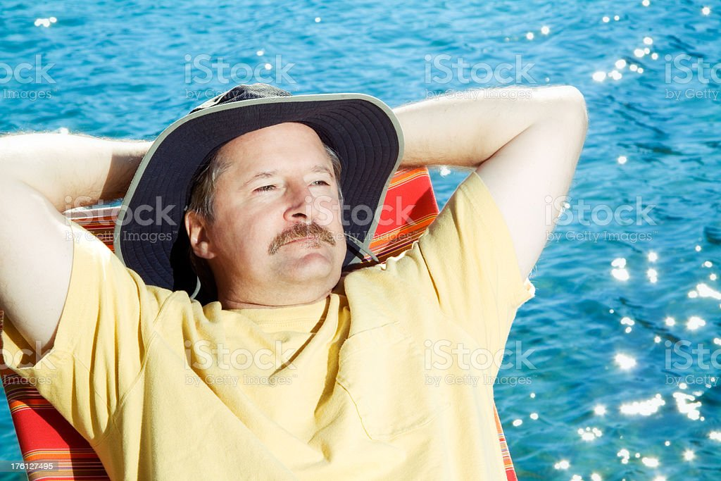 Man relaxing by the lake stock photo