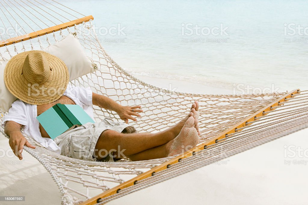 man relaxing in a hammock at the Caribbean beach royalty-free stock photo