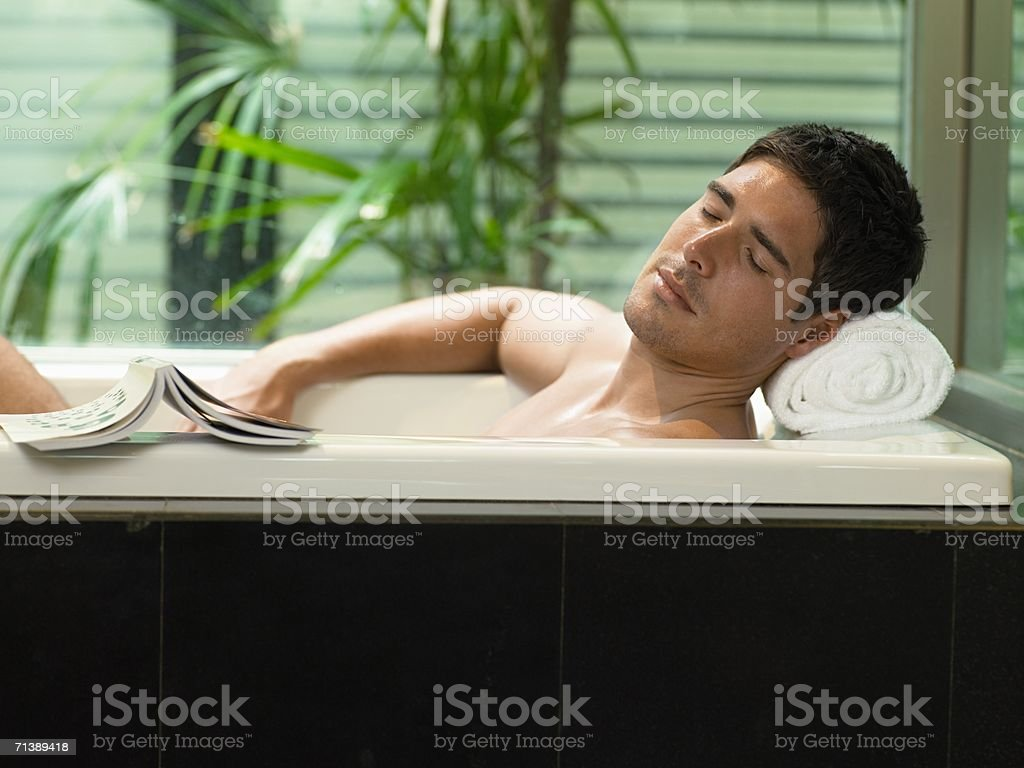 Man relaxing in the bath stock photo