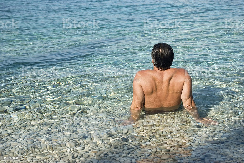 Man relaxing in the sea. royalty-free stock photo
