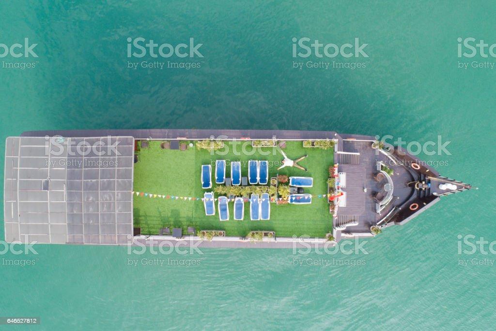 Man relaxing on a Cruise Boat, Ha Long Bay, Vietnam stock photo