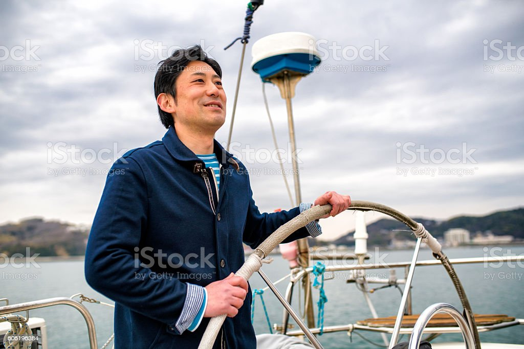 Man relaxing on a luxury yacht stock photo