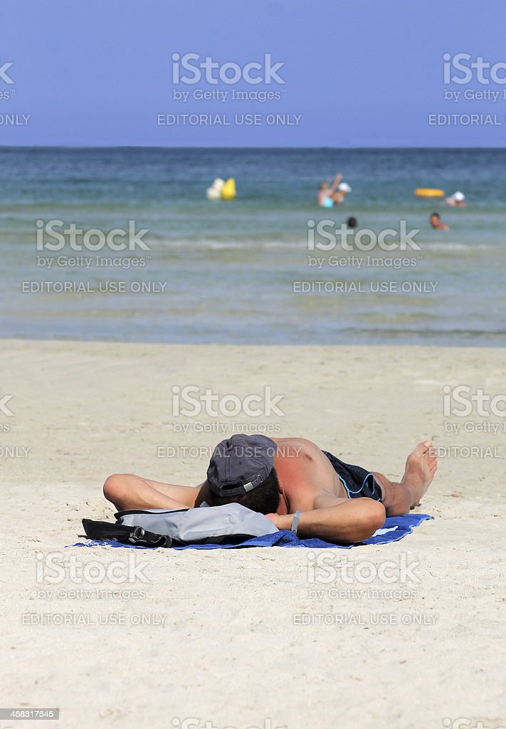 Man relaxing on beach in summer royalty-free stock photo