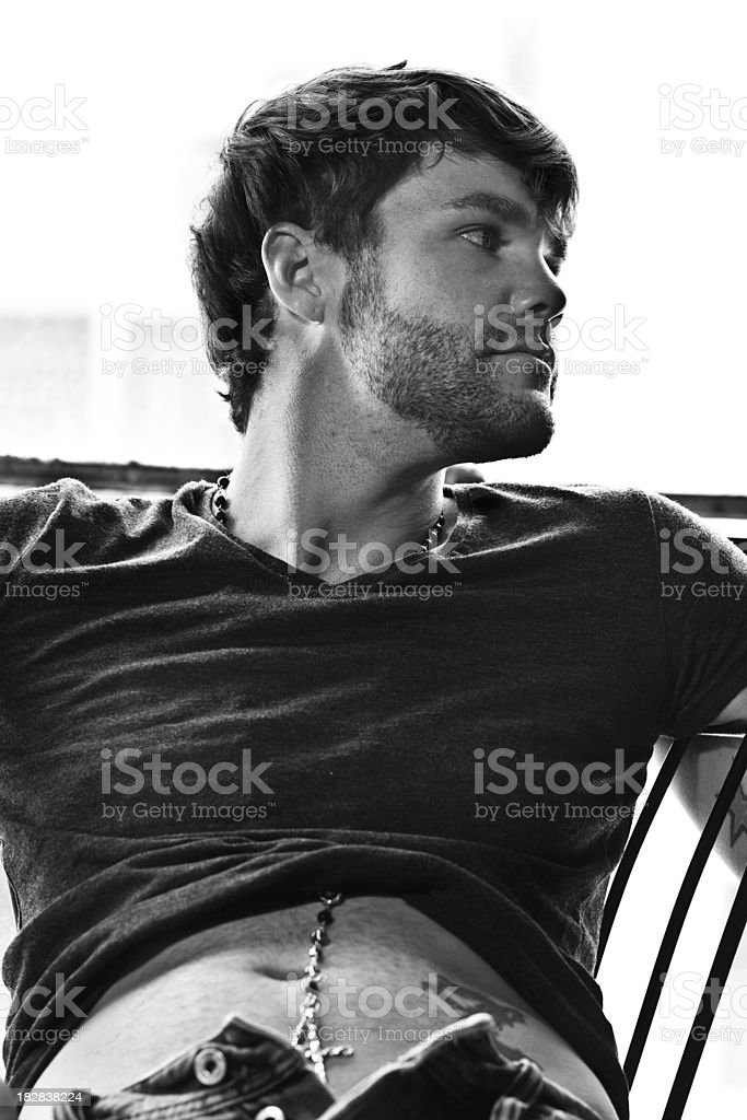 Man Relaxing on Chair - Black and White royalty-free stock photo