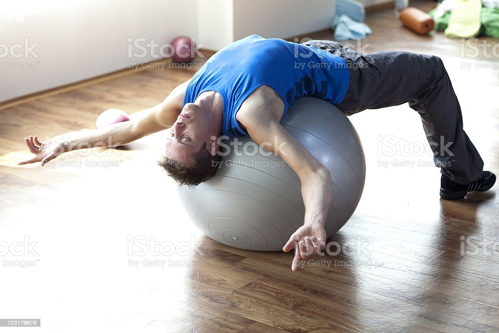Man relaxing on large stability ball royalty-free stock photo