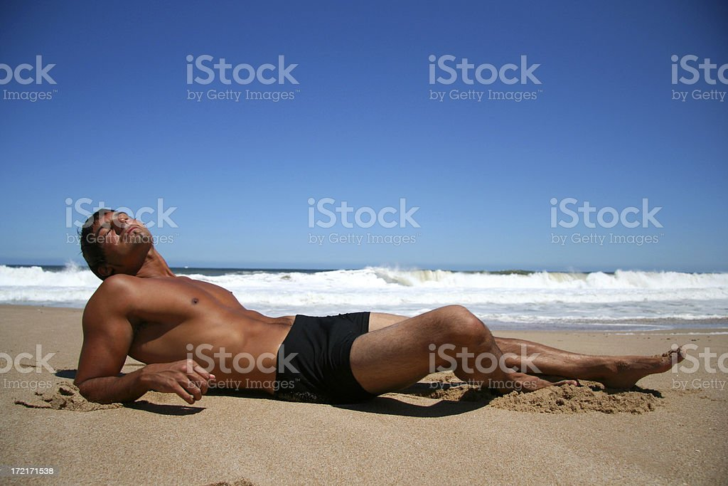 Man Relaxing on the Beach royalty-free stock photo