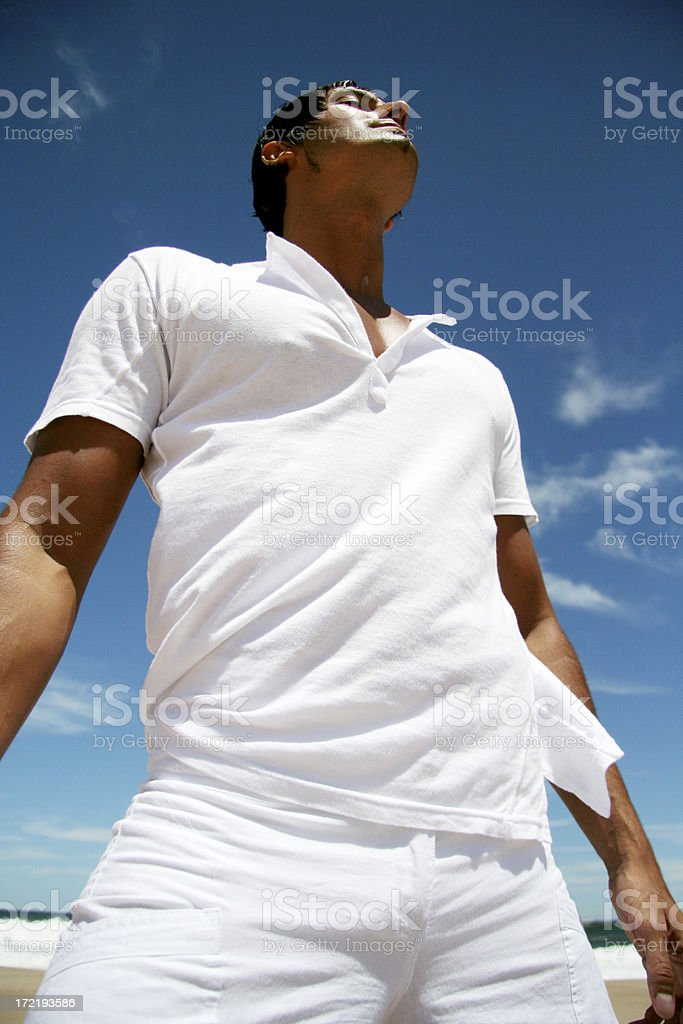 Man Relaxing on the Beach stock photo
