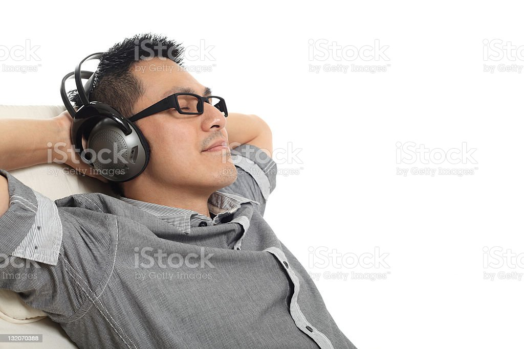 Man relaxing on the sofa and listening to music. royalty-free stock photo