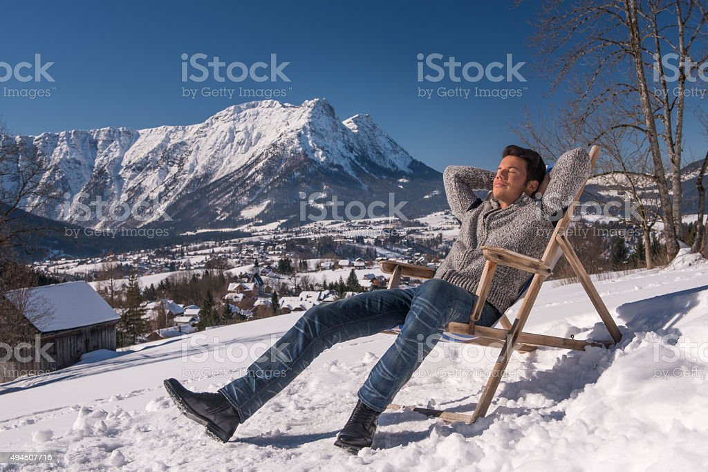 Man relaxing Outdoor in the Snow, European Alps stock photo