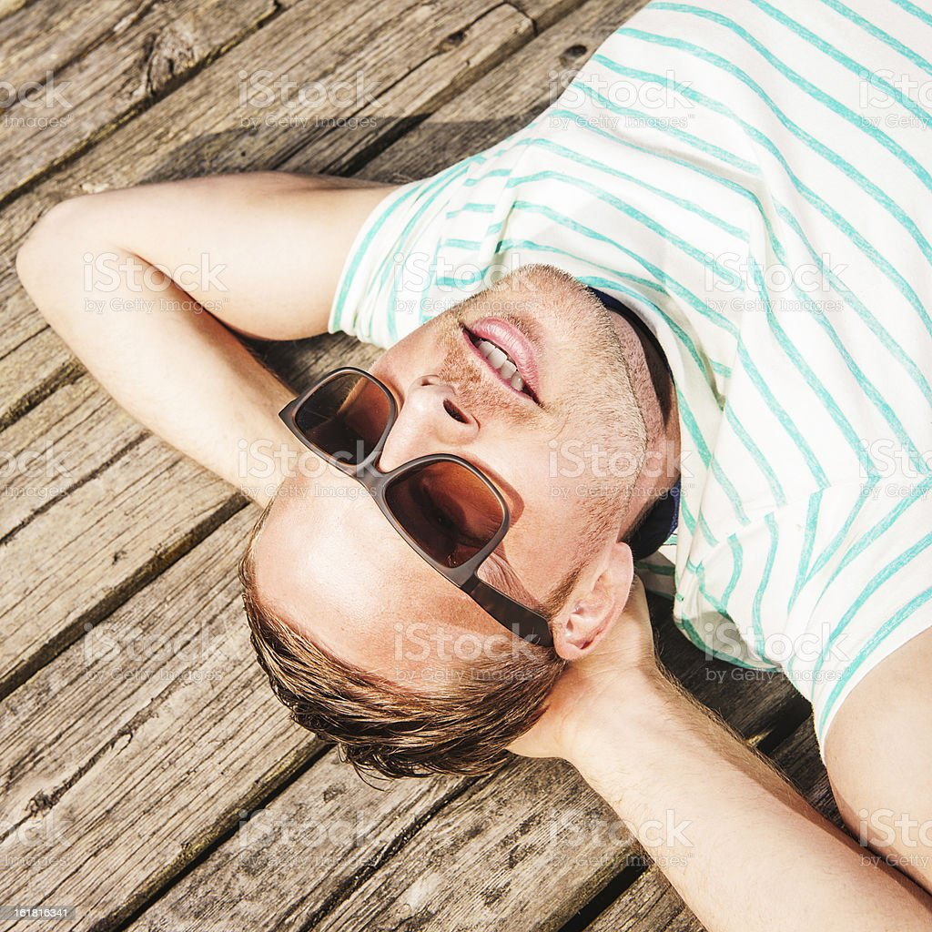 Man relaxing outdoors in sun royalty-free stock photo