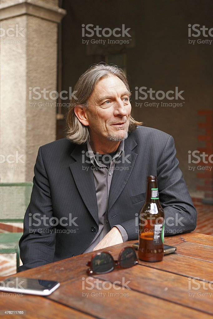 Man relaxing with a beer royalty-free stock photo