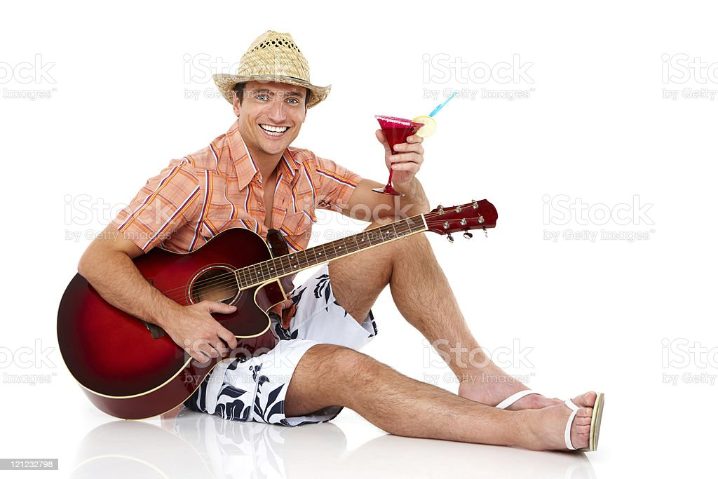 Man Relaxing With a Guitar and Drink - Isolated royalty-free stock photo