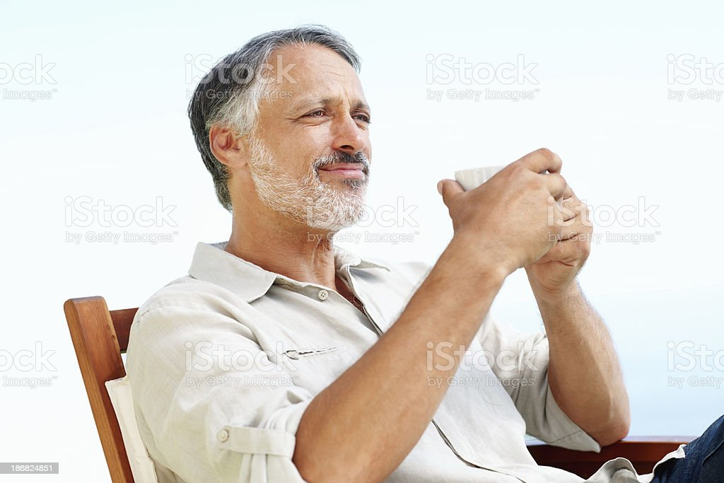 Man relaxing with cup of tea royalty-free stock photo