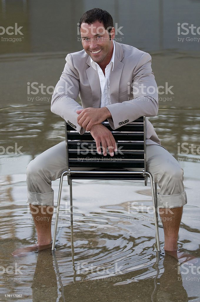 man relaxing with feet in water royalty-free stock photo