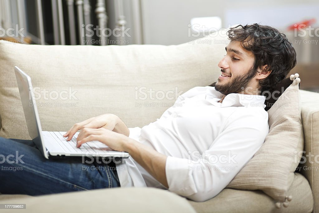Man relaxing with her laptop royalty-free stock photo