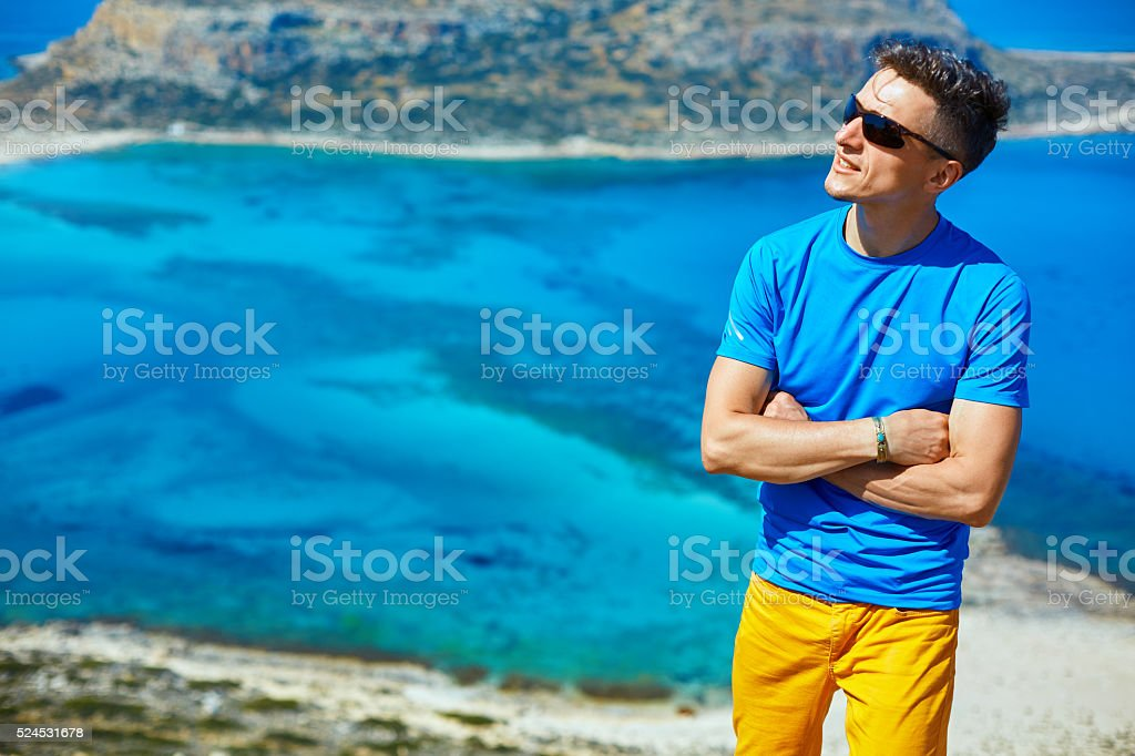 man reluxing on the rock stock photo