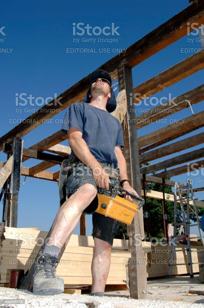 Man remote controlling a construction crane stock photo