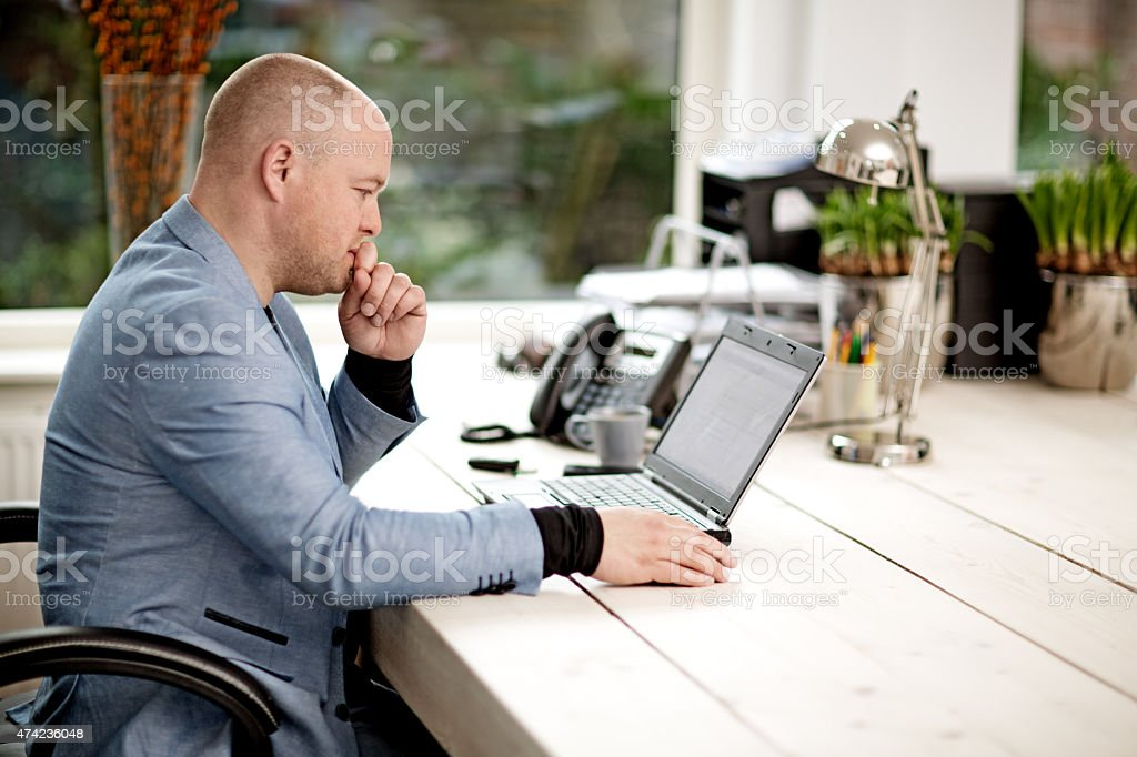 Man remote working from home office stock photo