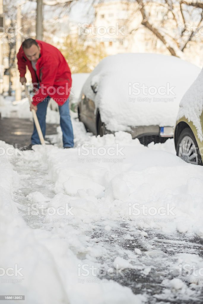 Man removing snow royalty-free stock photo