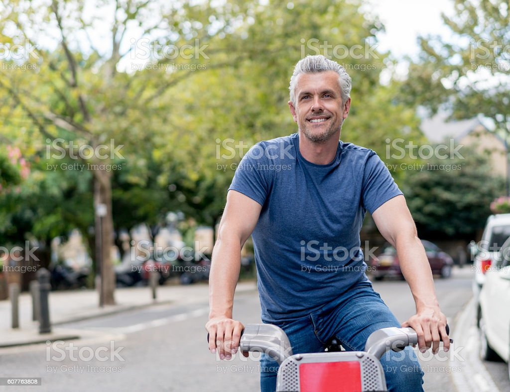 Man renting a bike in London stock photo
