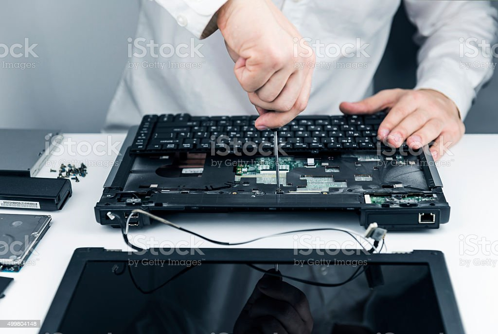 man repair laptop stock photo
