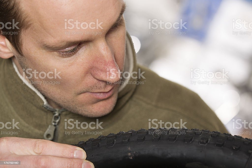 Man repairing a bicycle, new tire royalty-free stock photo