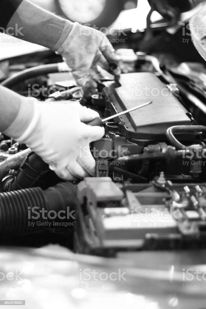 Man repairing a broken car by him self stock photo