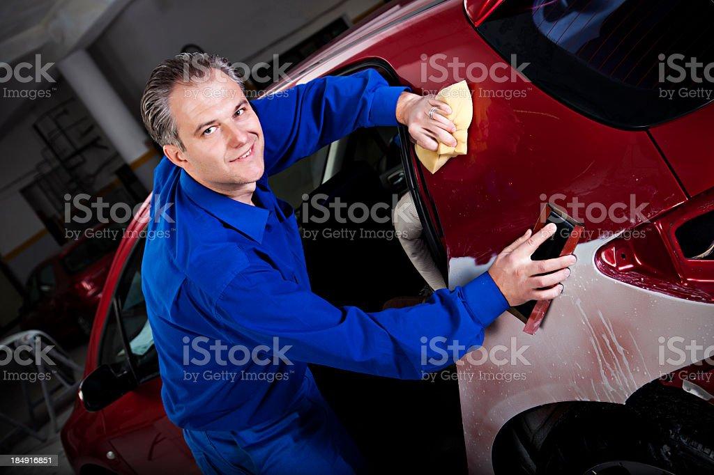 Man repairing a car under the hood stock photo