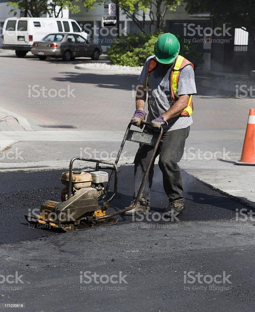 Man repairing asphalt. royalty-free stock photo