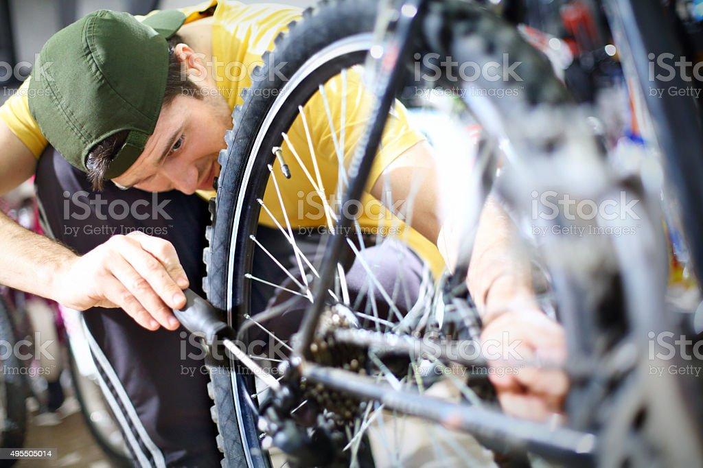 Man repairing bike. stock photo