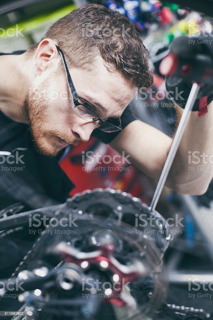 Man repairing bike stock photo