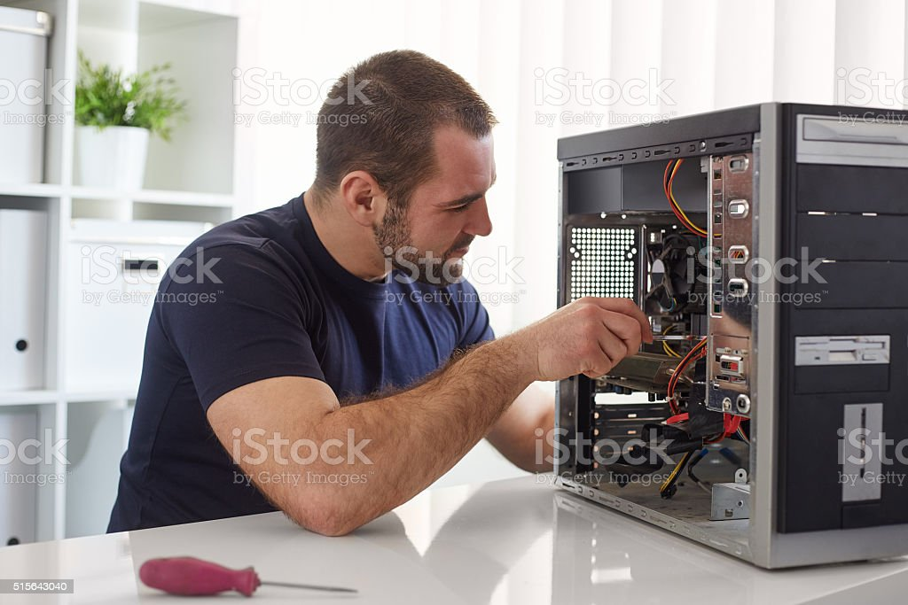 Man repairing computer stock photo