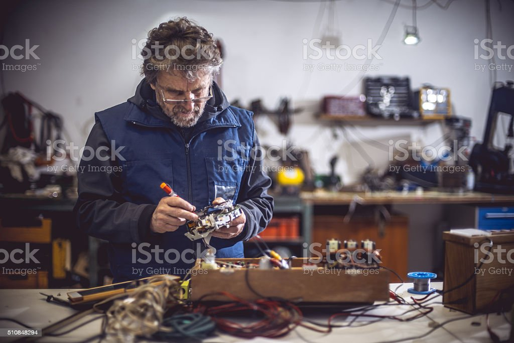 Man Repairing Electrical Components stock photo