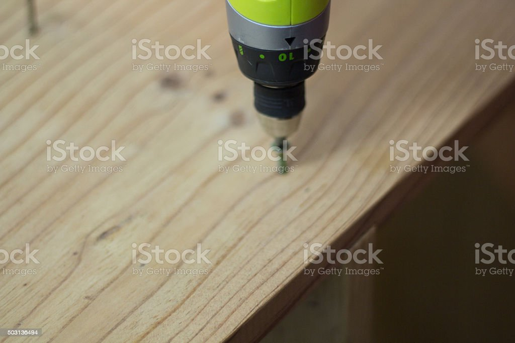 Man repairing furniture for use in his house. stock photo
