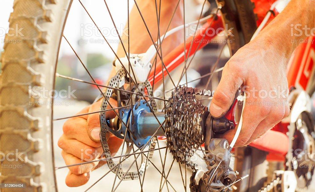 Man repairing his bicycle stock photo