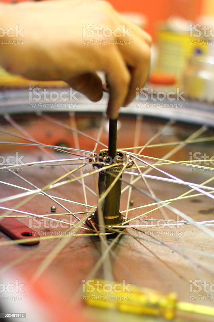 Man repairing his bicycle stock photo