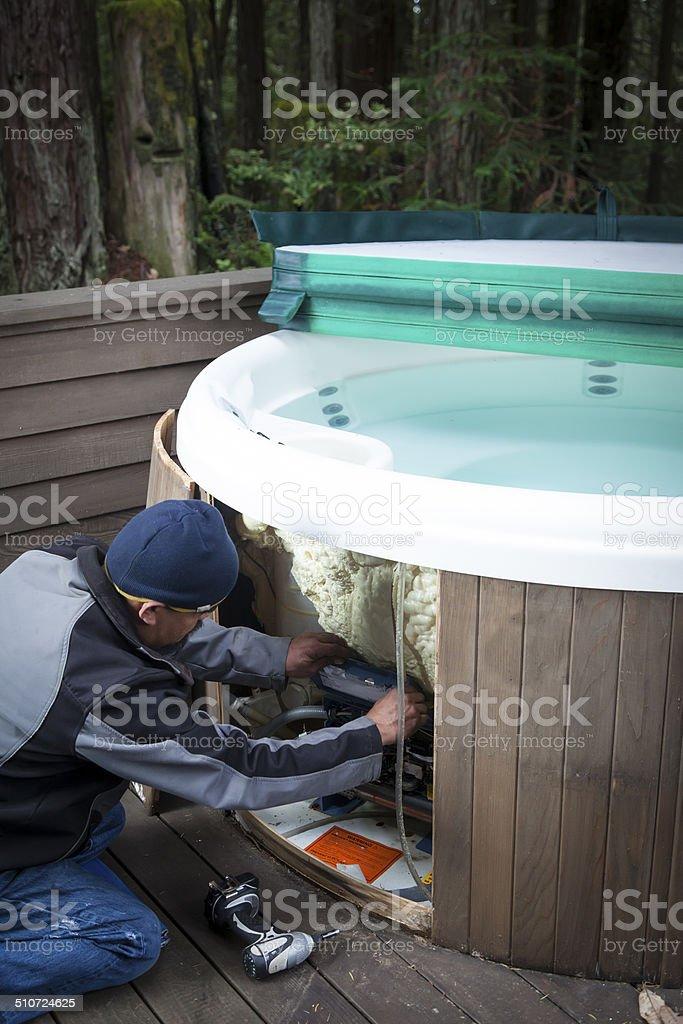 Man repairing Spa stock photo