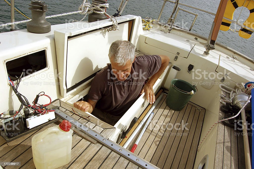 Man repairs his yacht royalty-free stock photo
