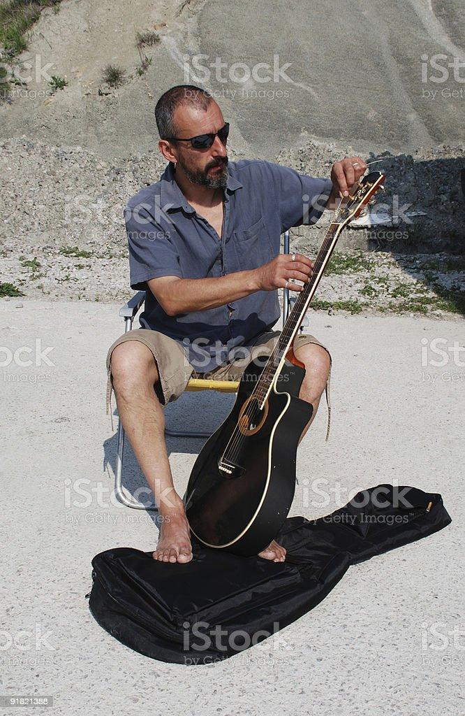 Man Replacing Guitar Strings royalty-free stock photo